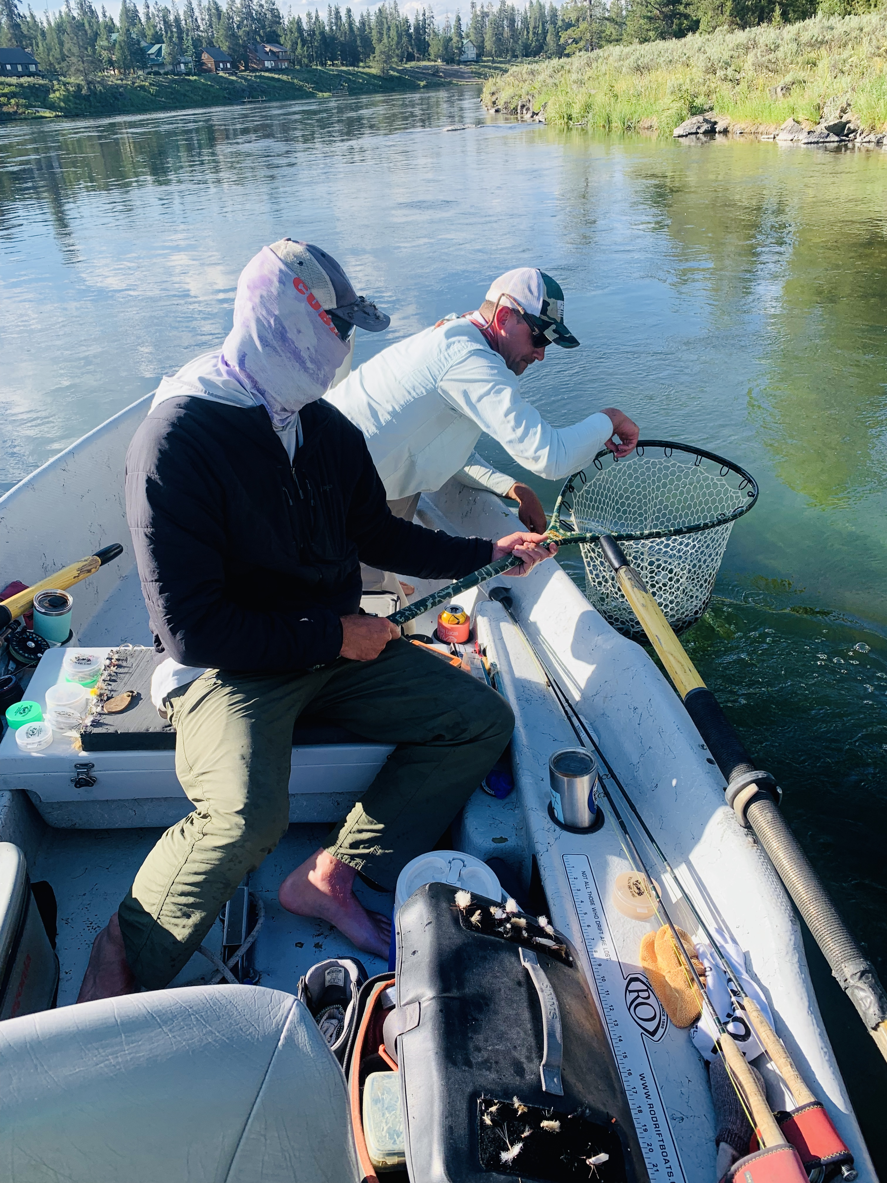 Patrick Gaffney of Trout Hunter Fly Fishing Guides helping to net a big fish out of the Henry's Fork River. For more travel and food posts check out sprouting-vitality.com #sproutingvitality #kenzinthekitch #mckenzieonthemove