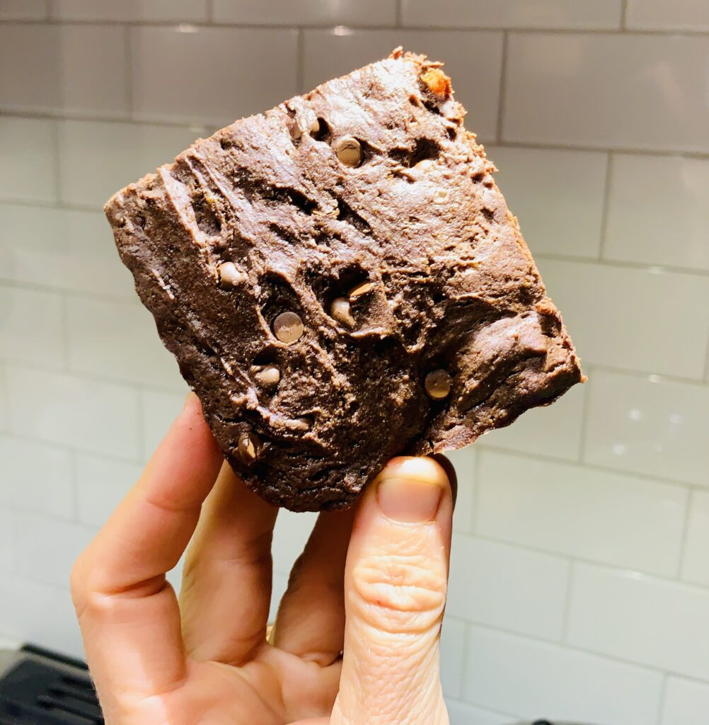 Delicious & pretty nutritious smoked dark chocolate brownies. Chocked full of high quality ingredients and melty chocolate in every bite. #kenzinthekitch #sproutingvitality