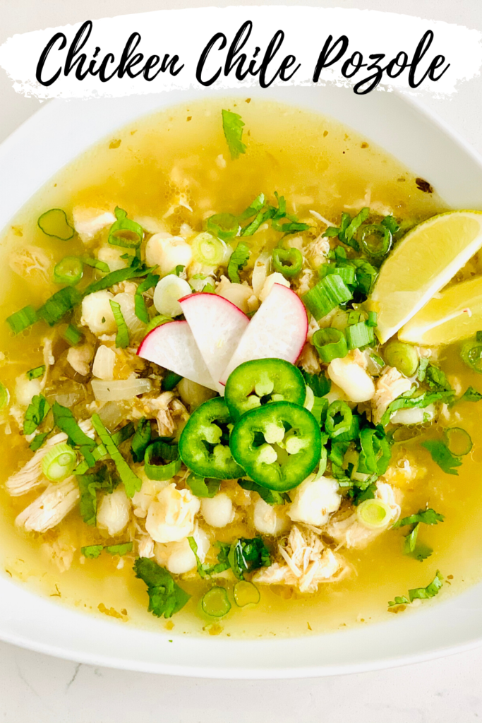 Delicious bowl of chicken chile pozole. This soup is chocked full of nutrient, flavor and texture. Topped with cilantro, jalapeno, radishes and sliced limes. #soup #healthy #recipe #sproutingvitality