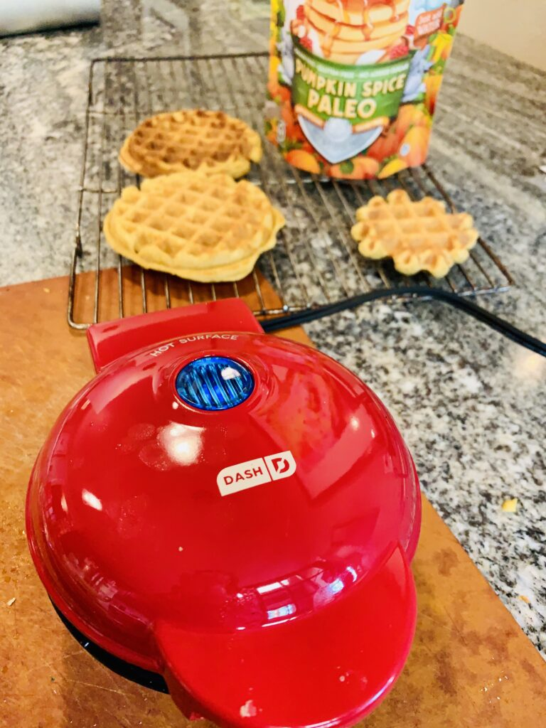 The cutest mini waffle maker that makes waffles in a matter of minutes. Perfectly done every time. #waffle #pumpkinspice #kenzinthekitch