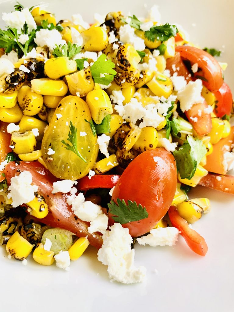 The Ultimate Grilled Corn Summer Salad! Taste of summer in every bite with the freshest ingredients! Follow @sproutingvitality for more recipes! #sproutingvitality #kenzinthekitch #recipes