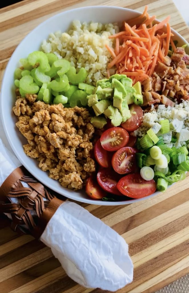 The Best Buffalo Chicken Bowl you want in your bowl! So easy to throw together but packed with incredible taste & flavors! Grab the recipe today! #kenzinthekitch #sproutingvitality #recipe