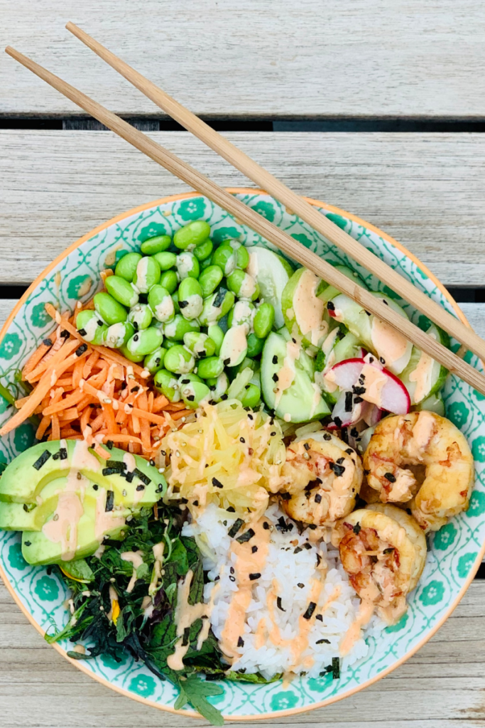Fresh simple shrimp bowl packed with whole food ingredients and topped with a spicy mayo drizzle. Must make recipe.